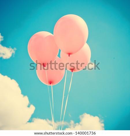 Pink Balloons on Retro Sky - stock photo