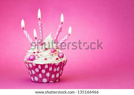 Pink birthday cupcake - stock photo