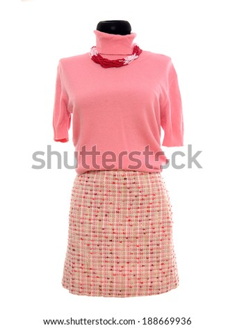 Pink blouse and skirt on mannequin. Woman autumn outfit on tailor's dummy isolated on white background. - stock photo