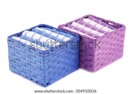 Pink, blue and white folded towels in boxes isolated on white background. - stock photo