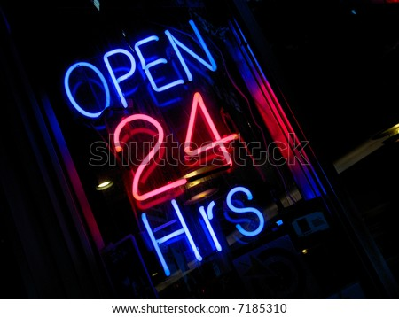 pink & blue neon Open 24 hours sign at night - stock photo
