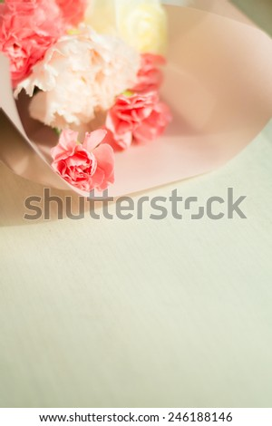 Pink bouquet of carnation flowers on wooden background - Mothers Day concept - stock photo