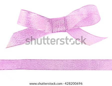 Pink bow and ribbon isolated on white - stock photo
