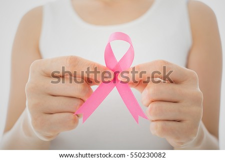 Pink Breast cancer awareness ribbon by woman who need to show healthcare concept.