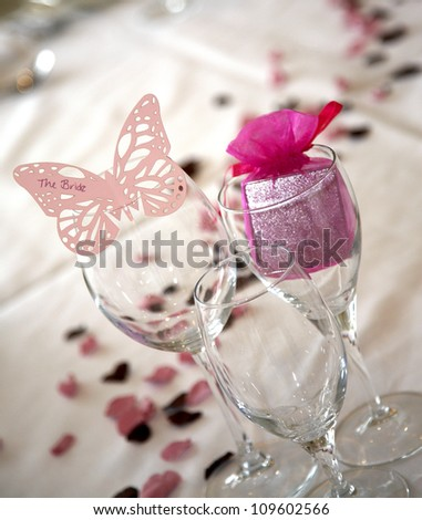 Pink butterfly place setting for the bride - stock photo
