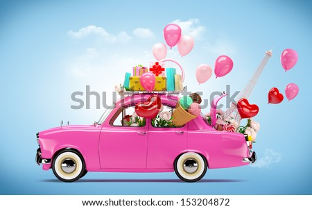 Pink car with symbols of love. Unusual Valentine's day background - stock photo