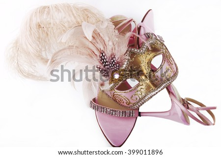 Pink carnival mask and sandals - stock photo