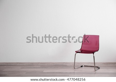 Pink chair in light room interior
