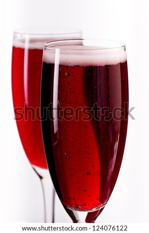 pink champagne in a flute served over a white background