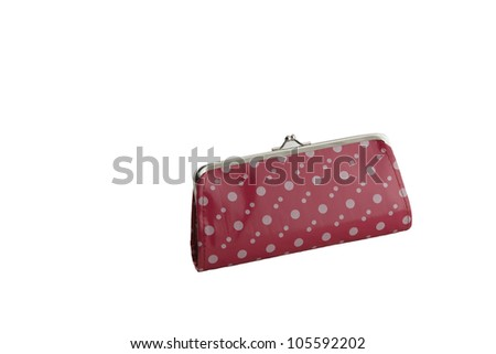 Pink  change coin purse with clasp and polka dots pattern isolated on a white background
