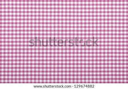 pink checkered fabric closeup , tablecloth texture - stock photo