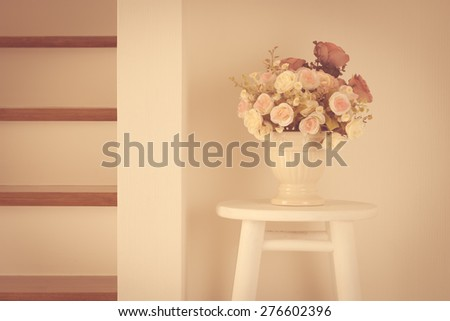 Pink cherry blossom flower bouquet on light  vintage and white wooden chair - stock photo