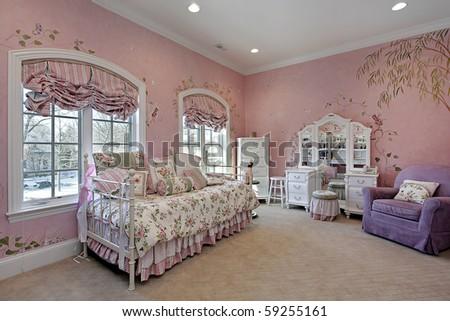 Pink children's bedroom in luxury suburban home - stock photo