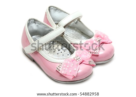 Pink children's shoes isolated on a white background - stock photo