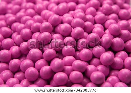 Pink chocolate candy ball - stock photo