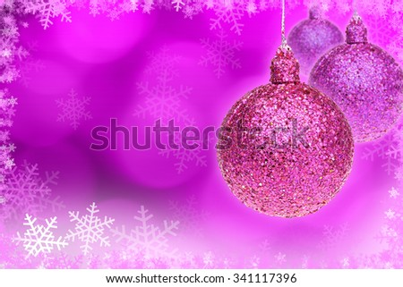 pink Christmas ball and pink bokeh background with copy space.