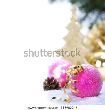 Pink christmas balls with decorations on a snow - stock photo