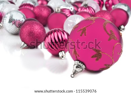 Pink christmas bauble ornaments on white - stock photo
