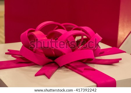 Pink Christmas present box decoration at a department store. - stock photo