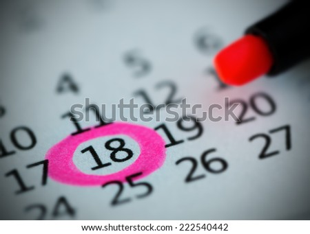 Pink circle. Mark on the calendar at 18. - stock photo
