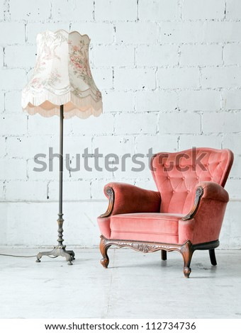 Pink classical style Armchair sofa couch in vintage room with desk lamp - stock photo