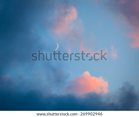 Pink clouds and moon heaven closeup - stock photo