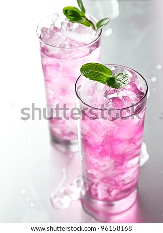 pink cocktail with mint garnish. - stock photo