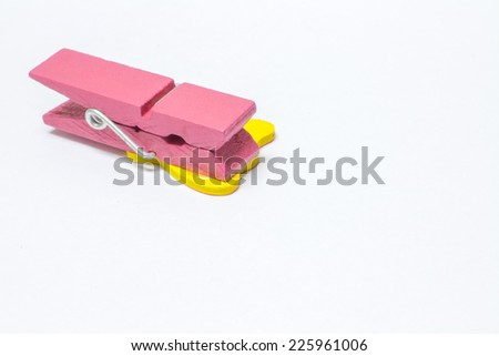 pink color wood peg on white background - stock photo