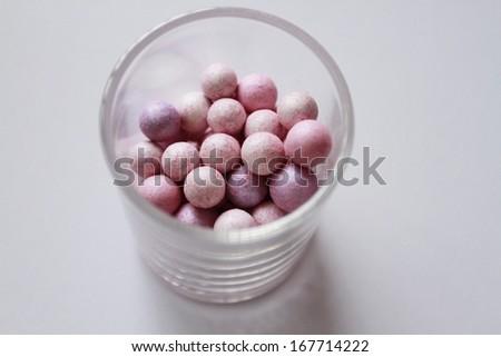 Pink cosmetics rouge balls. - stock photo