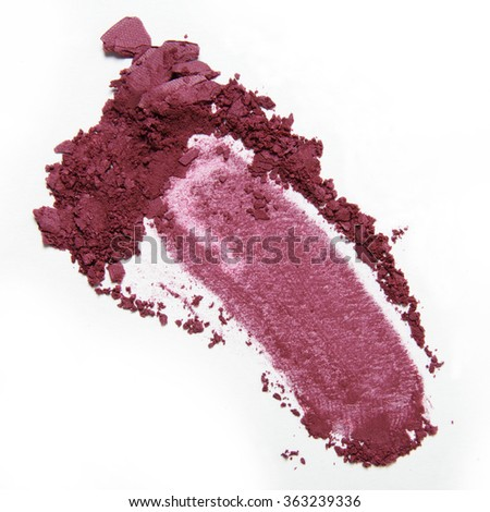 pink crumbled and smeared blush and eyeshadow on white background - stock photo