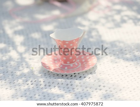 pink cup on the table outdoor - stock photo