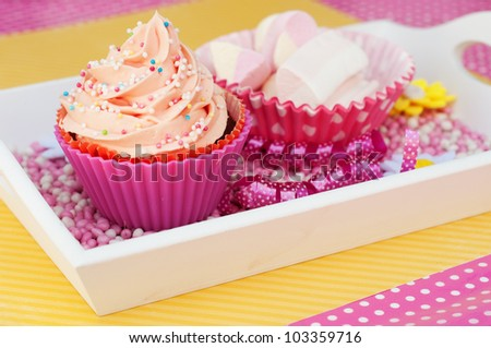 pink cupcake on a plateau with marshmallows - stock photo
