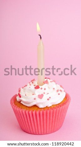 Pink cupcake with candle - stock photo