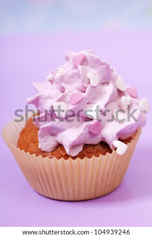 pink cupcake with white and pink hearts - stock photo
