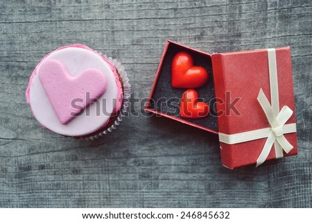 pink cupcakes, with cream ,decorated with hearts,Valentine's day,international women's day,love.Notepad - stock photo