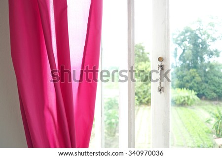 Pink curtain and white wooden window. Vintage Interior. - stock photo
