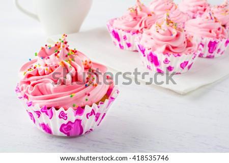 Pink delicious cupcakes.Selective focus. Birthday cupcakes. Homemade cupcake. Sweet cupcake. Gourmet cupcakes. Sweet dessert. Sweet pastry.  - stock photo