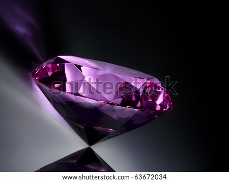 pink diamond on a dark background - stock photo