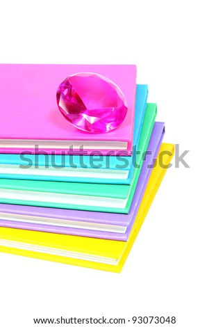 Pink diamond on top of a stack of colorful books (Pink Campaign)