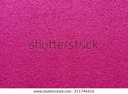 Pink Doormat in front of the hotel gate. - stock photo