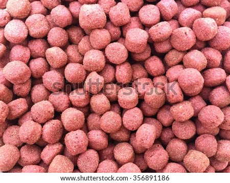 Pink dried dog and cat food background