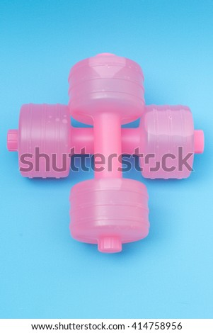 Pink dumbbells  on a blue background.