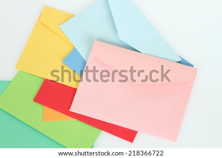 Pink envelope on the colorful envelopes - stock photo