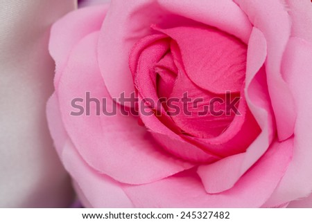 Pink Fabric Rose flower  artificial flowers on colorful background - stock photo