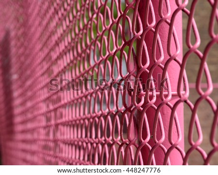 pink fence, shallow focus - stock photo