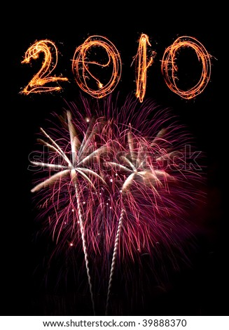 Pink fireworks and 2010 written with sparklers against black sky. - stock photo