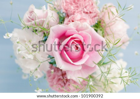 Pink flowers in a vase - stock photo