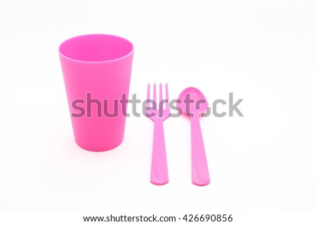 Pink fork ,spoon and plastic cup place on white background - stock photo