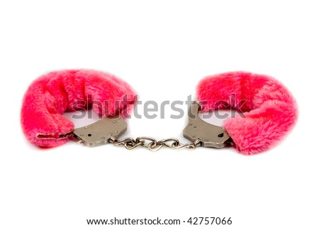 pink fur handcuffs isolated on white