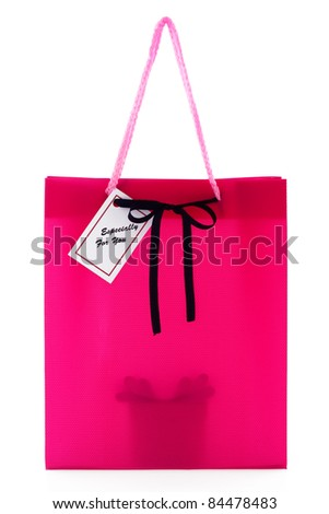 Pink gift bag with small card and a silhouette of a present inside isolated on white background - stock photo